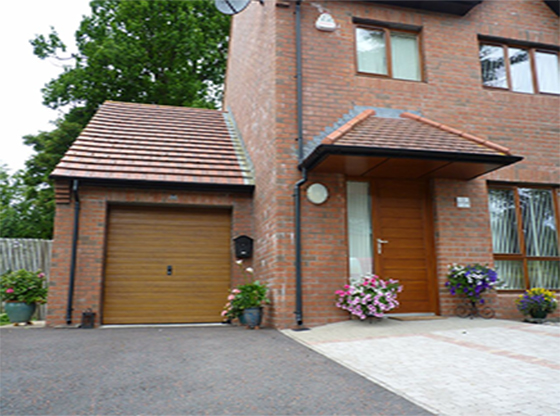 Golden Oak Ribbed Insulated Sectional Garage Door