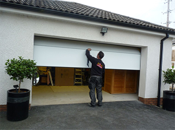 ThermAdor Residential White Smooth Flat Insulated Sectional Garage Door