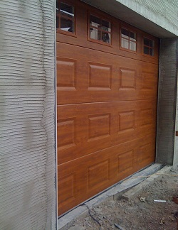 ThermAdor insulated sectional door Georgian Woodgrain Embossed Golden Oak with crossbar windows