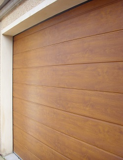 ThermAdor insulated sectional door Wide Ribbed Woodgrain Smooth Golden Oak
