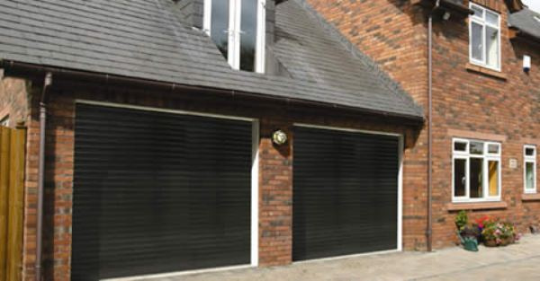 Black Seceuroglide insulated roller door with white PVC surround