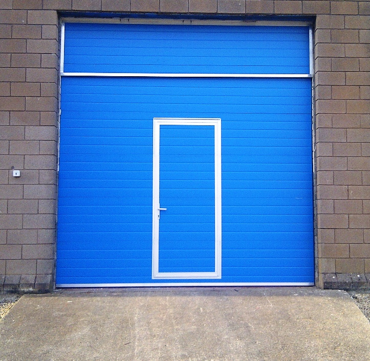 Thermador industrial door with pedestrian pass door.