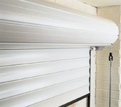 Insulated roller garage door inside of garage