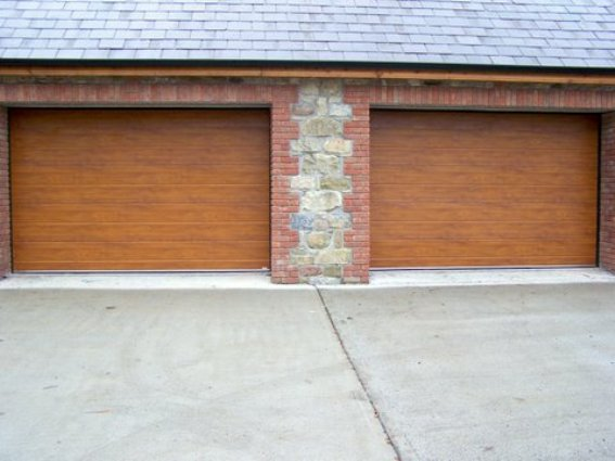 ThermAdor insulated sectional door golden oak Wide Ribbed