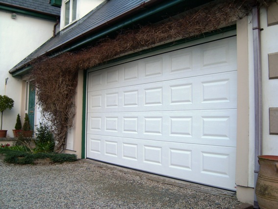 White Georgian panel ThermAdor sectional door with auto