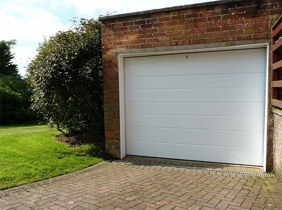 white wide ribbed smooth insulated sectional garage door